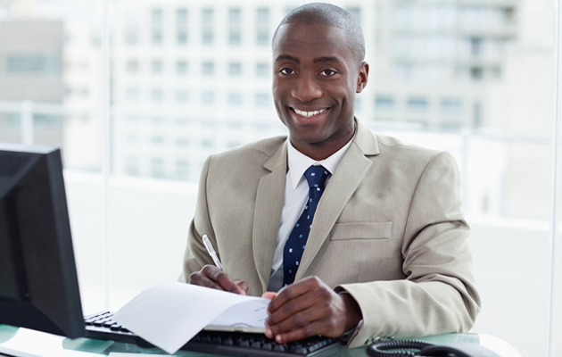 Smiling entrepreneur signing a document
